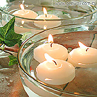 Small Round Unscented Floating Candle Discs in Elegant White or Ivory.