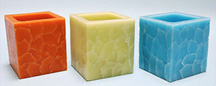 Scented Colorful Five Inch Square Lantern Candle Glows When Lit. Blocks Wind.
