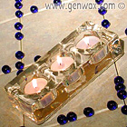 Trio Tealight Holder. The glass catches the glow of the candle flames. Simple and elegant.