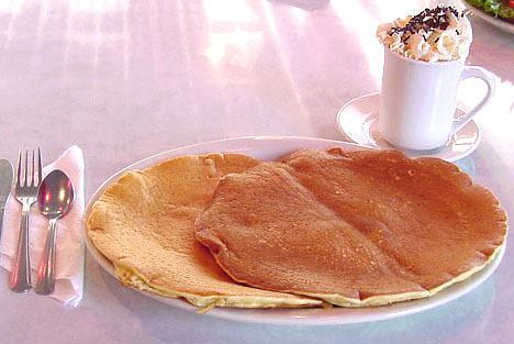 Two Plate Sized Pancakes and Hot Chocolate