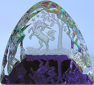 Crystal Figurine with Carved Frosted Unicorn in a Colorful Luminescent Crystal Forest. Enlarged to show detail. Actual size is 2.5 Inches Wide, 2.25 Inches Tall.