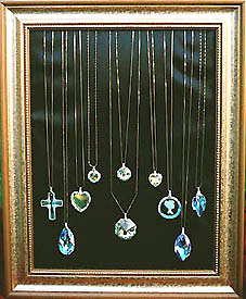 Display of Crystal Pendants on Gold Chains